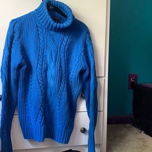 blue turtleneck sweater